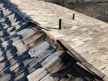 Damaged shingles from high wind